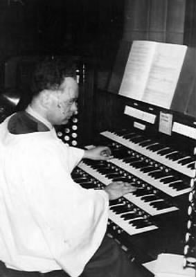 Dennis playing the organ