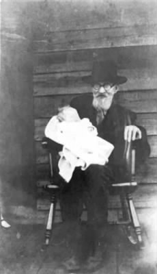 Edward Phillips holding his great-grandson Grover C. Phillips Jr.