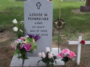 Louise's resting place beside her parents