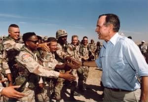 President Bush talks with the troops in Saudi Arabia