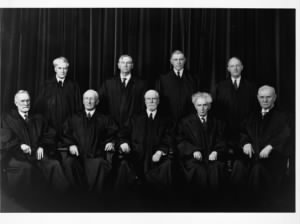 Group photograph, sitting, from left to right, are Justices Sutherland and McReynolds, Chief Justice Hughes, Justices Brandeis and Butler. Standing, left to right, Justices Cardozo, Stone, Roberts, and Black..JPG