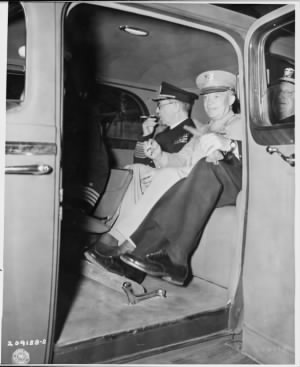 L_to_R,_Adm._Harold_Stark_and_Gen._Dwight_D._Eisenhower_in_car_preparing_to_ride_in_a_procession_behind_President..._-_NARA_-_19.jpg