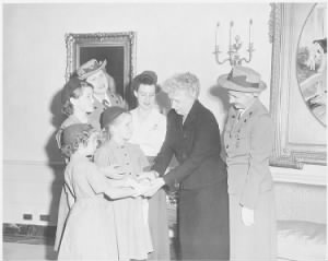 Photograph_of_First_Lady_Bess_Truman_at_the_White_House_with_a_delegation_of_Girl_Scouts,_who_are_presenting_her_with..._-_NARA_.jpg