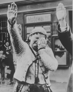 Sudeten woman unable to conceal misery salutes Hitler 1943.jpg